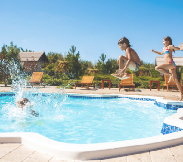 cheerful-children-rejoicing-jumping-swimming-pool